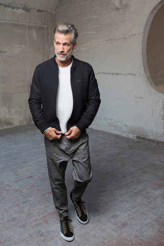 How to wear: dark green suede low top sneakers, grey chinos, white crew-neck sweater, black wool bomber jacket