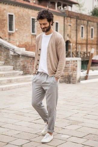 Men's Looks & Outfits: What To Wear In 2020: This combination of a beige cardigan and grey chinos embodies laid-back attitude and stylish practicality. Our favorite of a countless number of ways to finish off this outfit is with a pair of white canvas low top sneakers.