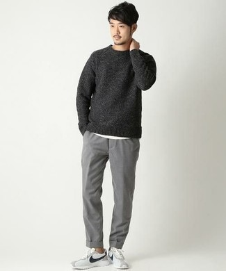 How to Wear a Charcoal Crew-neck Sweater For Men: Wear a charcoal crew-neck sweater and grey chinos and you'll look like the raddest dude around. White and black athletic shoes will easily tone down an all-too-dressy look.
