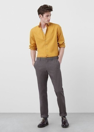 Men's Looks & Outfits: What To Wear In 2020: For effortless style without the need to sacrifice on functionality, we like this combo of a mustard long sleeve shirt and grey chinos. Breathe a hint of sophistication into your outfit with dark purple leather brogue boots.