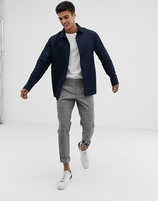 Men's Looks & Outfits: What To Wear In 2020: A navy shirt jacket and grey plaid chinos matched together are a smart match. Feeling bold? Change things up a bit by sporting white leather low top sneakers.