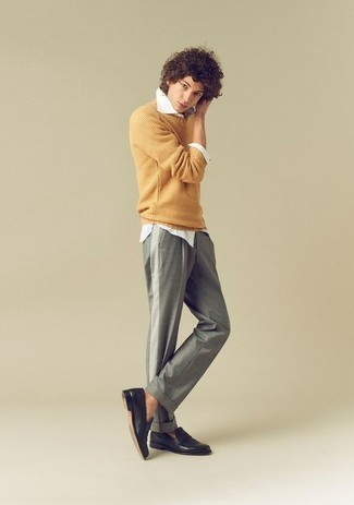 How to Wear a Yellow Crew-neck Sweater For Men: This casual combination of a yellow crew-neck sweater and grey chinos is ideal if you want to go about your day with confidence in your look. Bump up the formality of this outfit a bit by wearing a pair of black leather loafers.