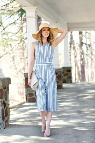 How to wear: beige straw hat, grey leather clutch, grey leather heeled sandals, light blue vertical striped jumpsuit