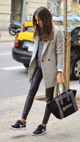 Look absolutely chic without trying too much in a grey coat and black leather leggings. Dress down this outfit with monochrome trainers. It's is a fantastic option if you're putting together a standout getup for awkward transition weather.
