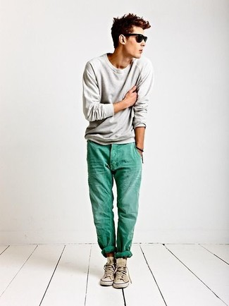 How to wear: grey crew-neck sweater, mint jeans, beige high top sneakers, black sunglasses