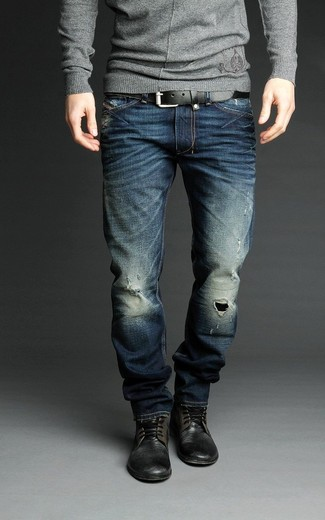 How to wear: grey crew-neck sweater, navy ripped jeans, black leather casual boots, black leather belt
