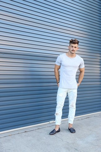How to wear: grey crew-neck t-shirt, light blue ripped jeans, navy leather loafers, silver bracelet