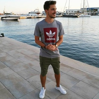 How to wear: grey print crew-neck t-shirt, olive shorts, white leather low top sneakers, black leather watch