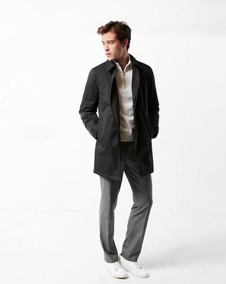 How to wear: white leather low top sneakers, grey dress pants, beige zip neck sweater, black raincoat