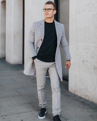 How to wear: black leather low top sneakers, grey dress pants, black crew-neck sweater, grey overcoat