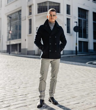 How to wear: black leather chelsea boots, grey wool dress pants, grey turtleneck, black pea coat