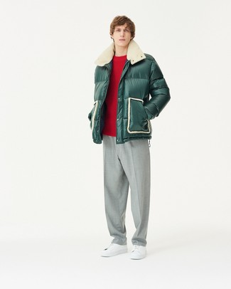 How to wear: white leather low top sneakers, grey dress pants, red crew-neck sweater, dark green puffer jacket