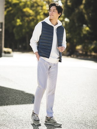 How to wear: grey suede low top sneakers, grey dress pants, white hoodie, navy gilet