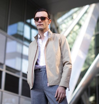How to wear: burgundy sunglasses, grey wool dress pants, white long sleeve shirt, beige harrington jacket