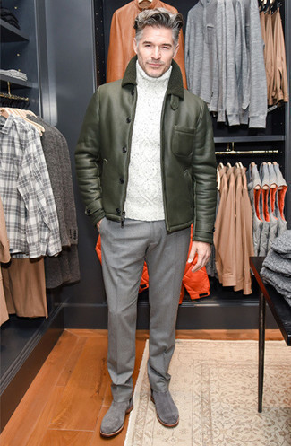 Men's Looks & Outfits: What To Wear In Winter: Putting together an olive shearling jacket with grey wool dress pants is an on-point option for a classic and refined outfit. Grey suede chelsea boots pull the outfit together. In winter, when practicality is critical, it can be easy to settle for a less-than-stylish ensemble in the name of convenience. But this ensemble is a bright example that you can actually stay comfortable and remain stylish in winter.