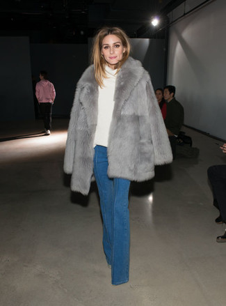 Olivia Palermo wearing Grey Fur Coat, White Cowl-neck Sweater, Blue Flare Jeans