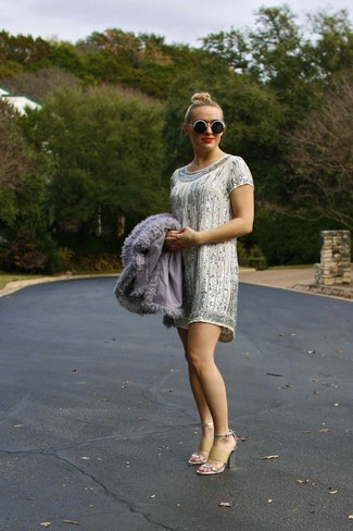 How to wear: grey fur jacket, silver sequin shift dress, silver leather heeled sandals, black and white beaded sunglasses