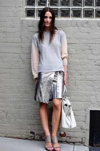 How to Wear a Grey Sweatshirt For Women: If you're a fan of classic combos, then you'll like this combination of a grey sweatshirt and a silver leather mini skirt. Let your outfit coordination chops really shine by completing your ensemble with grey leather heeled sandals.