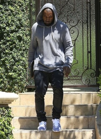 Kanye West wearing Grey Hoodie, Black Jeans, Grey Athletic Shoes