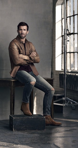 How to wear: dark brown suede cowboy boots, grey ripped jeans, black crew-neck t-shirt, brown leather shirt jacket