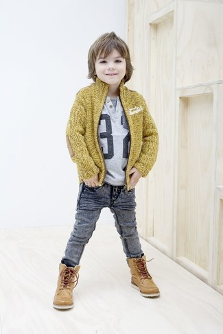 How to Wear Grey Jeans For Boys: Help your little angel look fashionable by suggesting that he pair a mustard cardigan with grey jeans. Tan leather boots are a wonderful choice to complement this style.
