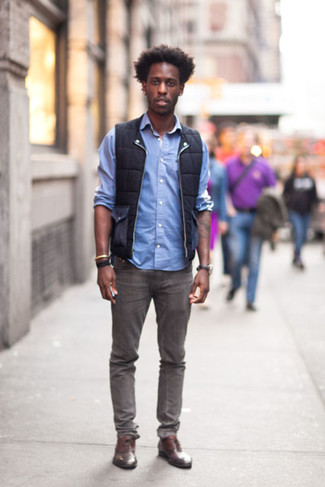 How to wear: brown leather oxford shoes, grey jeans, light blue long sleeve shirt, black gilet