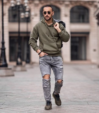 How to wear: olive athletic shoes, grey ripped jeans, olive hoodie, grey denim jacket
