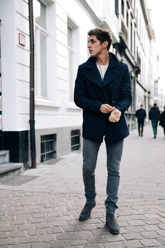 How to Wear a Navy Pea Coat: A navy pea coat and grey jeans paired together are a perfect match. Go ahead and complete your look with a pair of charcoal suede chelsea boots for a dose of class.