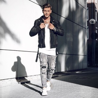 5fac00a7c3 How to wear: white and black leather low top sneakers, grey ripped jeans,