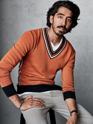 How to wear: grey jeans, white crew-neck t-shirt, orange v-neck sweater
