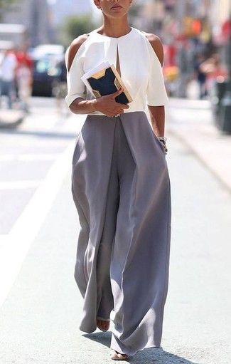 How to wear: grey jumpsuit, navy suede clutch