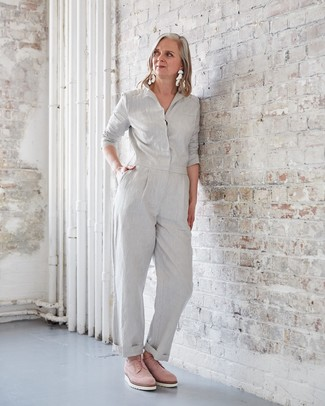 How to wear: grey jumpsuit, pink suede oxford shoes, white earrings