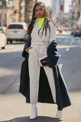 How to wear: white leather ankle boots, grey jumpsuit, yellow turtleneck, navy fluffy coat