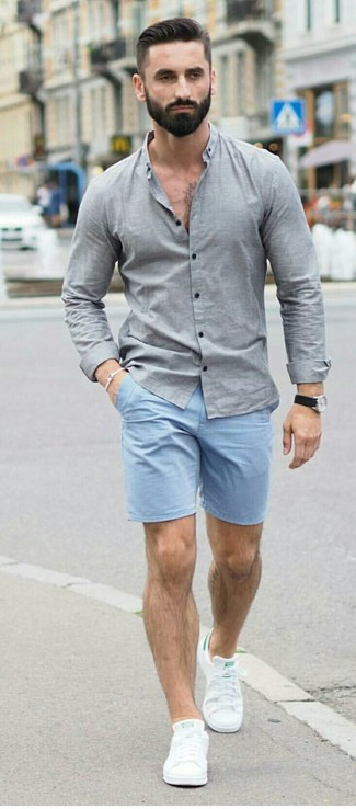 How to wear: grey chambray long sleeve shirt, light blue shorts, white leather low top sneakers, black leather watch