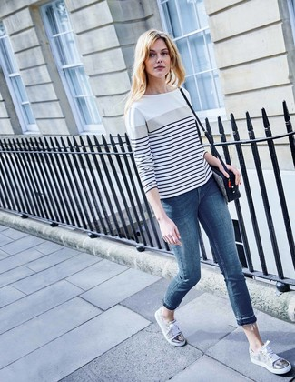 How to wear: black and white leopard leather crossbody bag, grey low top sneakers, blue skinny jeans, white and navy horizontal striped long sleeve t-shirt