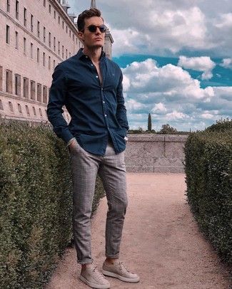 How to wear: navy sunglasses, grey suede low top sneakers, grey plaid chinos, navy long sleeve shirt