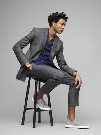 How to wear: black leather watch, grey canvas low top sneakers, navy polo, grey suit