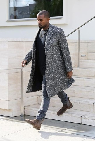 Kanye West wearing Grey Herringbone Overcoat, Black Crew-neck T-shirt, Grey Jeans, Brown Suede Chelsea Boots