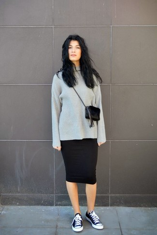Wear a charcoal knit oversized sweater with a black midi skirt for a refined yet off-duty ensemble. Black and white canvas low top sneakers will contrast beautifully against the rest of the look.