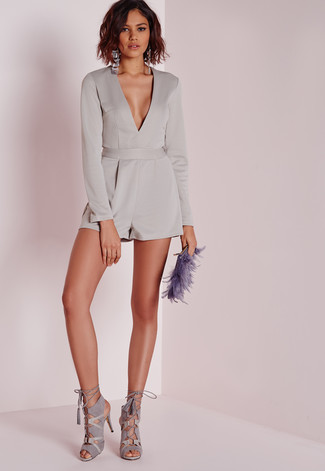 How to wear: grey silk playsuit, grey suede heeled sandals, violet fur clutch, silver earrings