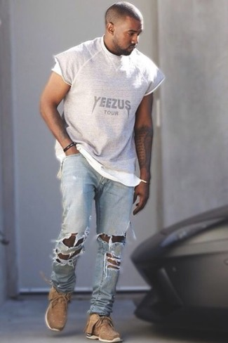 Kanye West wearing Grey Print Crew-neck T-shirt, Light Blue Ripped Jeans, Tan Athletic Shoes