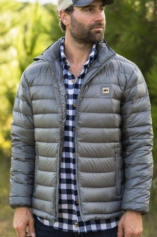 How to wear: grey puffer jacket, white and navy gingham long sleeve shirt, navy jeans, beige baseball cap