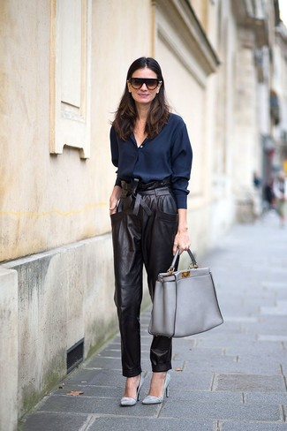 How to wear: grey leather tote bag, grey leather pumps, black leather tapered pants, navy dress shirt
