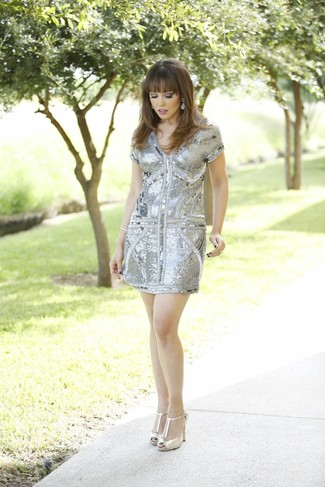 How to wear: grey sequin sheath dress, gold leather pumps, silver earrings