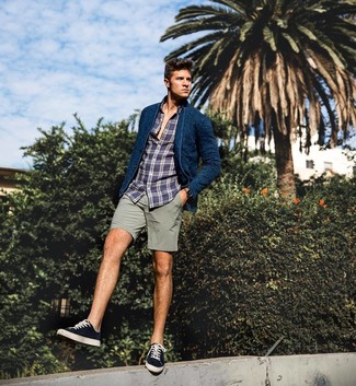 How to wear: black and white canvas low top sneakers, grey shorts, navy plaid long sleeve shirt, navy knit blazer