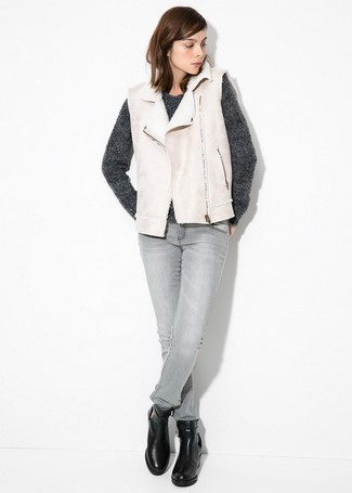 How to wear: black leather ankle boots, grey skinny jeans, charcoal crew-neck sweater, beige shearling vest