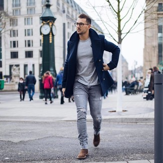 How to wear: brown suede chelsea boots, grey ripped skinny jeans, grey crew-neck t-shirt, navy pea coat
