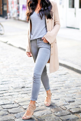 How to wear: beige suede heeled sandals, grey skinny jeans, grey v-neck t-shirt, tan cardigan