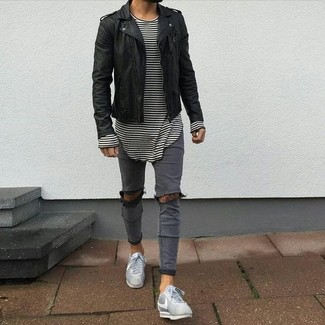 How to wear: grey low top sneakers, grey ripped skinny jeans, white and black horizontal striped long sleeve t-shirt, black leather biker jacket