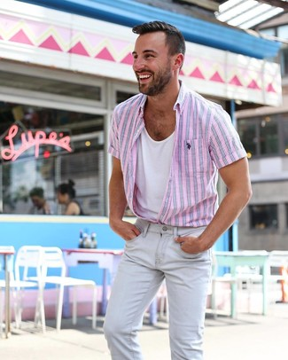 How to wear: grey skinny jeans, white tank, pink vertical striped short sleeve shirt